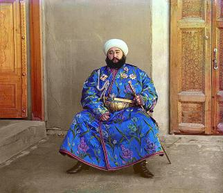 """The Emir of Bukhara, Alim Khan (1880-1944), poses solemnly for his portrait, taken in 1911 shortly after his accession. As ruler of an autonomous city-state in Islamic Central Asia, the Emir presided over the internal affairs of his emirate as absolute monarch, although since the mid-1800s Bukhara had been a vassal state of the Russian Empire. With the establishment of Soviet power in Bukhara in 1920, the Emir fled to Afghanistan where he died in 1944."" (Library of Congress)"