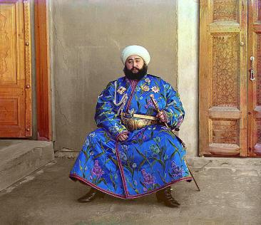 """""""The Emir of Bukhara, Alim Khan (1880-1944), poses solemnly for his portrait, taken in 1911 shortly after his accession. As ruler of an autonomous city-state in Islamic Central Asia, the Emir presided over the internal affairs of his emirate as absolute monarch, although since the mid-1800s Bukhara had been a vassal state of the Russian Empire. With the establishment of Soviet power in Bukhara in 1920, the Emir fled to Afghanistan where he died in 1944."""" (Library of Congress)"""