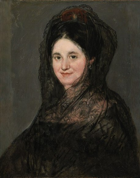 "Retrato de una dama en una mantilla negra, Francisco de Goya. The familiar Spanish comb and mantilla. Now and then some nuance of it shows up, but it is never seen in pure form today. The industrial age has killed it for anything but ""costume movies."""