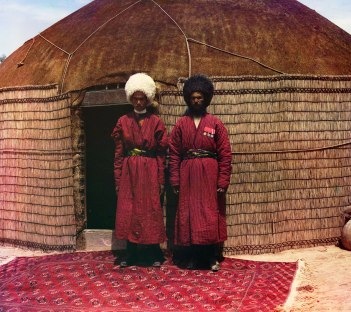 Father and eldest son stand outside their yurt (house). Bairam-Ali, Turkmenistan.